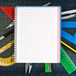 Royalty-Free Stock Photo: Notebook for school supplies on the background jeans.