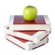 Stock Photo: Stack of books and apple. On white background.