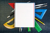 Notebook for school supplies on the background jeans. — Stock Photo