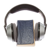 Wireless headphones and a book. On a white background. — Foto Stock