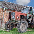 Antique tractor on a farm in the village. — Stock Photo