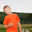 Stock Photo: Boy on nature. Everything is fine.