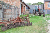 Antique tractor and plow on the farm. — Foto de Stock