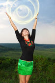 A girl holds a round ball of light of the sun. — Stock Photo