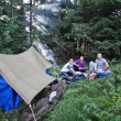Stock Photo: Friends in campaign with tent in Carpathiforest.
