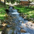 Mountain stream flowing beside houses. — Stock Photo