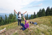 Group of happy campers at the top of the Carpathian Mountains. — Stock Photo