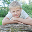Stock Photo: Portrait of boy outdoors.