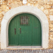 Old door arch gate in the old city of Faro. Portugal. - Stock Photo