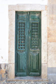 Old wooden green doors on the streets of Portugal. — Stock Photo