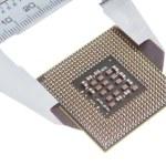 Vernier caliper measures the processor. Closeup. — Stock Photo #13635654