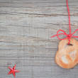 Stock Photo: Christmas cookies and star anise. On textured wood.