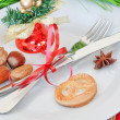 Arrangement of Christmas objects, bells, and nuts. — Stock Photo