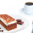 Piece of chocolate cake and coffee. On a white background. — Stock Photo