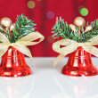 Two red Christmas bell. Against the background bokeh. — Stock Photo