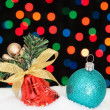 Christmas bell and ball in the snow. On the background bokeh. — Stock Photo