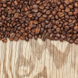 Background from coffee beans and wooden textures. — Stock Photo