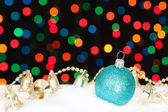 Blue Christmas ball and bells in the snow. On the background bok — Stock Photo