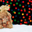Christmas present in the snow on a background of colored bokeh. — 图库照片