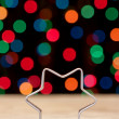 Star shape for baking Christmas cookies on a background bokeh. — Stock Photo
