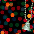 Royalty-Free Stock Photo: Golden Christmas bell on a background bokeh lights.