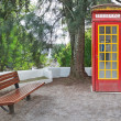 Stock Photo: Vintage phone booth cabin in park.