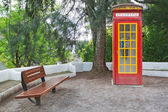 The vintage phone booth cabin in the park. — Stock Photo