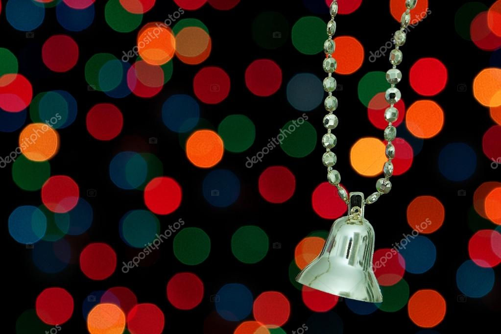 Golden Christmas bell on a background bokeh lights. — Stock Photo #14098927