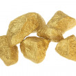 Gold nuggets stones on a white background. — Stock Photo