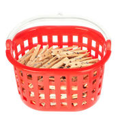 Set of pegs clothespins in the red basket. On a white background — Stock Photo