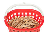 Set of clothespins in the red basket. Closeup. — Stock Photo