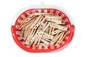Clothespins in red basket. View from above. Closeup. — Stock Photo