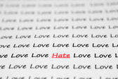 The word hate, love written closeup. — Stock Photo
