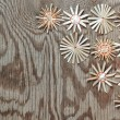 Stock Photo: Straw Christmas snowflakes on wooden texture.