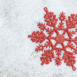 Christmas decoration snowflake on white snow. — Foto de Stock