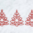 Three decorative Christmas tree closeup on the snow. — Stock Photo