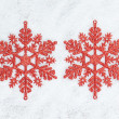Four decorative Christmas snowflakes closeup on snow. — Stock Photo #14742141