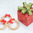 Stock Photo: Christmas gift box and decorative straw wreath. In snow.