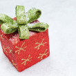 Stock Photo: Christmas gift box with bow on snow.