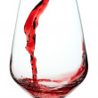 Splash of red wine in a glass. Closeup. — Stock Photo