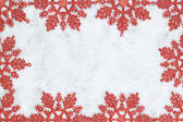 Christmas decorative frame with snowflakes closeup on snow. — Stock Photo