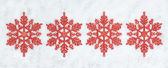 Four decorative Christmas snowflakes closeup on snow. — Stock Photo