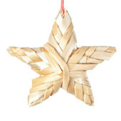 Straw Christmas star. On a white background. — Stock Photo