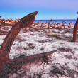 Old cemetery rusty anchors. Portugal, beach stones king. - Stock Photo