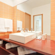 Stock Photo: Bathroom with wash basin and lighted candles.