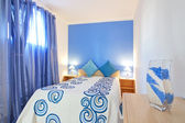 A small bedroom in blue. In Decoration. — Stock Photo