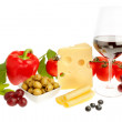 Aperitif of fruits and vegetables wine and cheese. On a white ba — Stock Photo