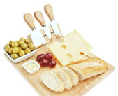 Set for cutting cheese and snacks for wine. On a white backgroun — Stock Photo