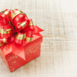 Rich beautiful gift with a red bow. — Stock Photo