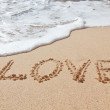 The word love in the sea on the beach in Valentine Day. Closeup. — Stock Photo